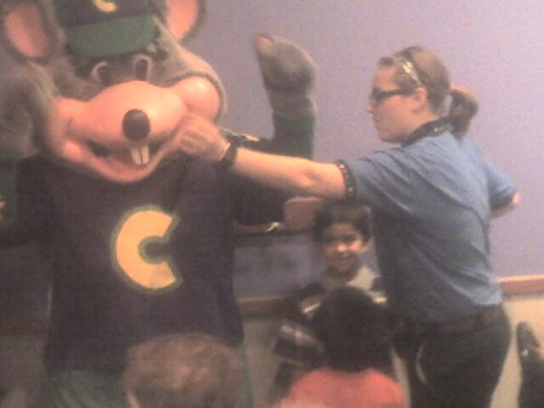 An employee punches out her boss Chuck E. Cheese, King of Kid Kingdom